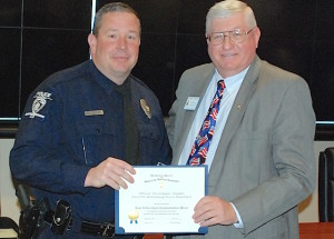 Mecklenburg chapter vice president Jim Prosser, on right, presents the SAR Law Enforcement Commendation Medal to CMPD police officer James Meadows.