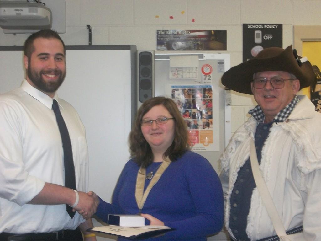 Honors History Teacher Seth Warren congratulates Ellen Burgess 2015 Knight Essay Winner following award by Halifax Resolves Chapter Pres. Ken Wilson