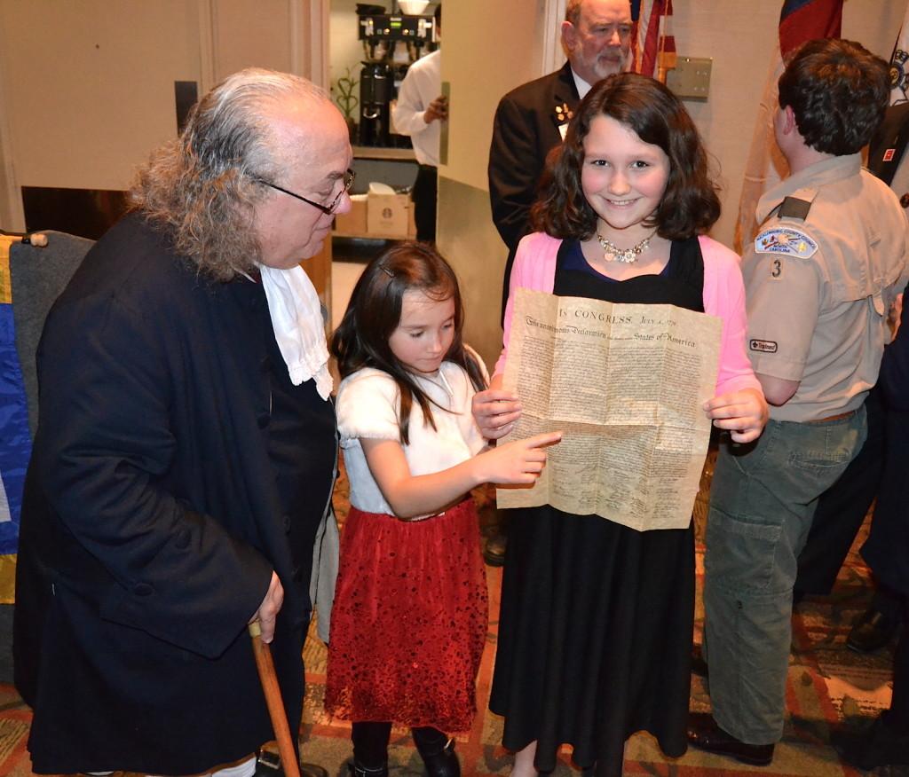 SAR member Adam Zollinger's children meet Benjamin Franklin on February 18 2016 at the Mecklenburg Chapter's President's Day Community Dinner on February 18 2016.