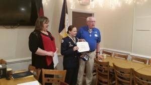 Cadet Samantha Jones receives Lower Cape Fear Chapter Enhance JROTC cadet Award from Compatriot Gary O. Green as mother looks on