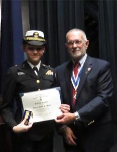 Rolf Maris, New Bern Chapter President, and awardee, New Bern High School cadet, Katlyn Golden.