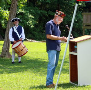 Rolf Maris, New Bern Chapter President, played cadence during the ceremony.