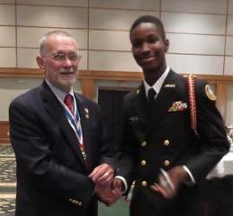 Rolf Maris, New Bern Chapter President, and awardee, Havelock High School cadet, Michael Williams.