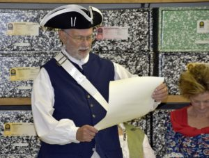 Rolf Maris, NEW Bern Chapter President, reads the Constitution to students.
