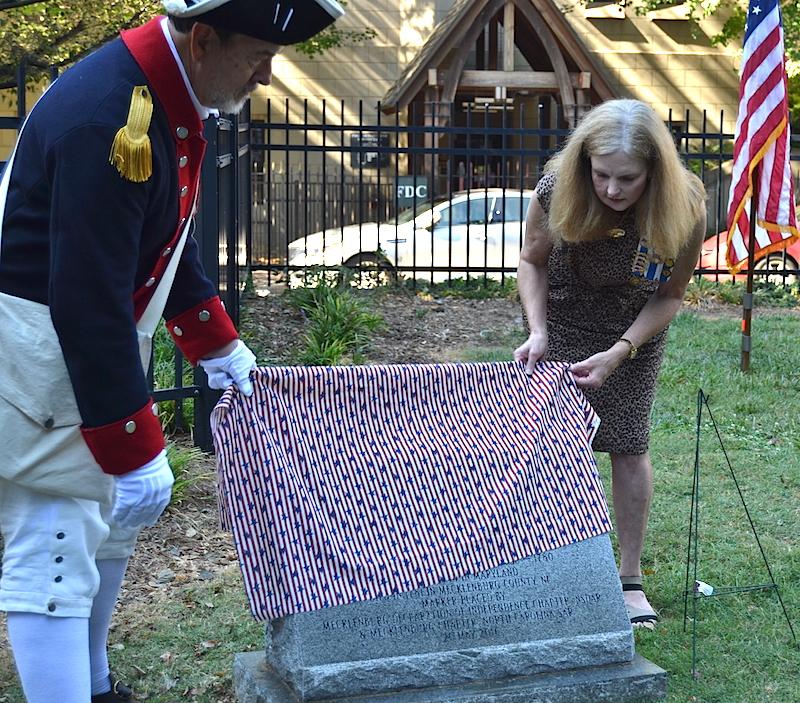 Mecklenburg chapter president Ken Luckey unveils the monument for Patriot Ephraim Brevard on September 24 2016 in Charlotte.